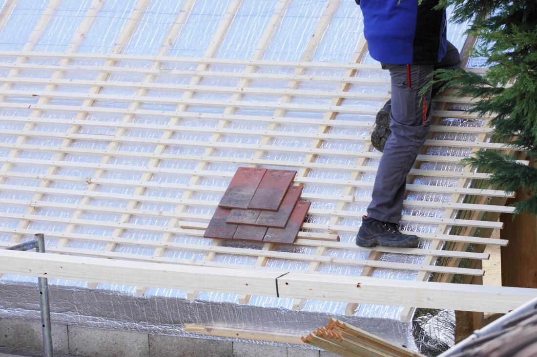 professional roofer working on roofing installation